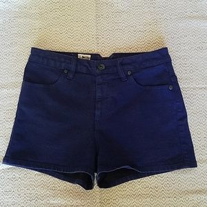 Dark blue high waisted Volcom shorts.